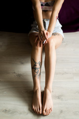 Close up of tattoo legs
