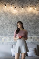 Asian womanwith coffee