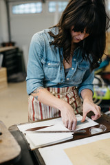 Letterpress artist in her studio
