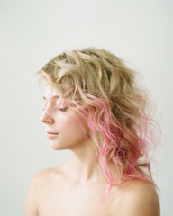 Young blond with pink locks