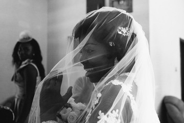 Close up of African bride waiting to go into church.