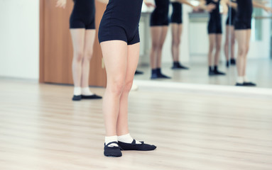 Close Up Of Feet In Children's Ballet Dancing Class