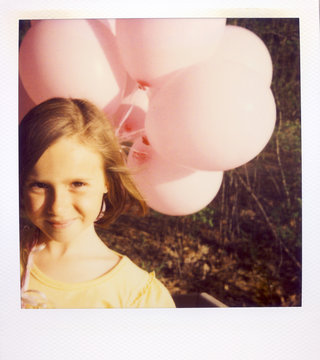 A Girl Holding A Bunch Of Pink Balloons On A Spring Evening