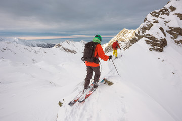 Skiers getting on top of the mountain