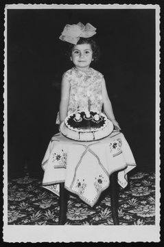 Young girl celebrating her third birthday in 1968