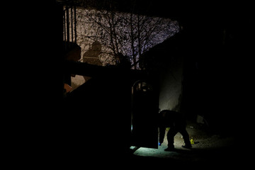 Forensics work at the crime scene where three woman were found dead after a shoot out inside a house according to the local police, in Ciudad Juarez