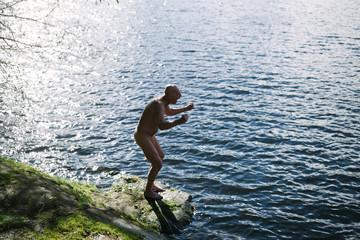 Nude man yelling at the lake