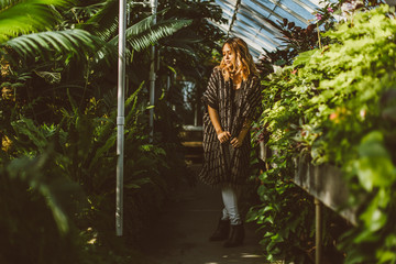 Portrait Of Young Beautiful Asian American Woman In Greenhouse