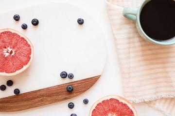 preparing breakfast in the morning: grapefruit, blueberries, and coffee