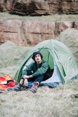 Man sitting in tent