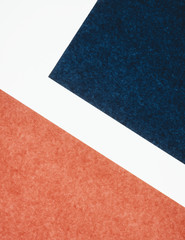 Detail of red and blue sheets of construction paper