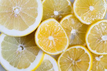 Slices of lemon and orange close-up. Vitamin C in citrus fruits. Fruit yellow background.