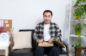Blind man reading braille