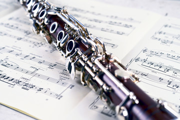 close up clarinet on music notes