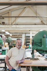 Portrait of smiling craftsman in cabinet shop