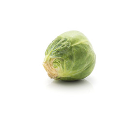 Raw Brussels sprout isolated on white background one fresh head.