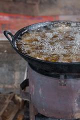 Large oil wok frying Burmese street food, Myanmar