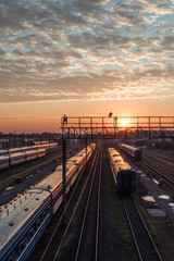 Railway station with trains on sunrise