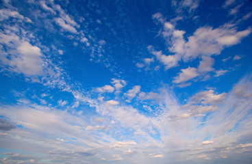 Background of a picturesque blue cloudy sky. Wall mural