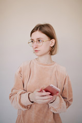 Indoor portrait of attractive young female in nerd glasses