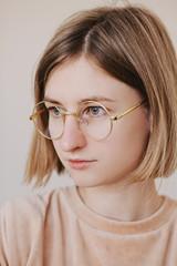 Portrait of blonde female in glasses
