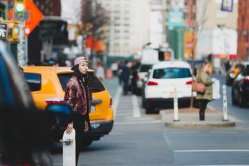 Female skater in the city street