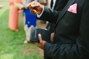 Close Up of an African man's hands holding a Bible.