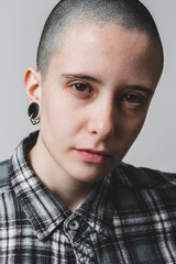 Androgynous Young Woman Posing Tough as a Male