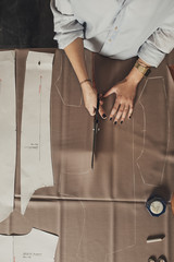 Woman Tailor Cutting Fabric