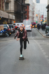 Young woman skating in the city