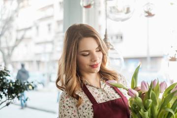 Beautiful Female Florist Holding Tulips