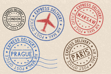Set of colored ink postmarks with european cities. On beige background