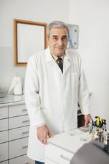 Portrait of dentist in dental surgery