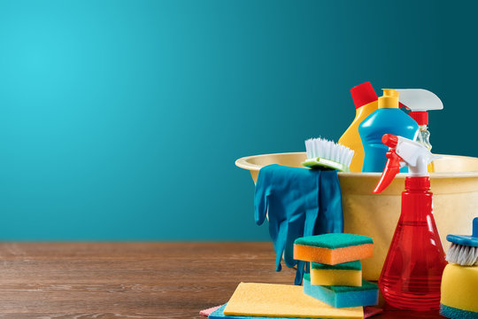 Image with various tools for cleaning the premises and cleaning agents on a blue background. The concept of cleaning the premises, cleanliness.