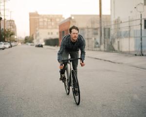 Man Rides Bicycle Through the City