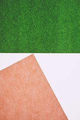 Detail of pink and green sheets of construction paper