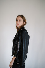 portrait of a beautiful girl in a leather jacket