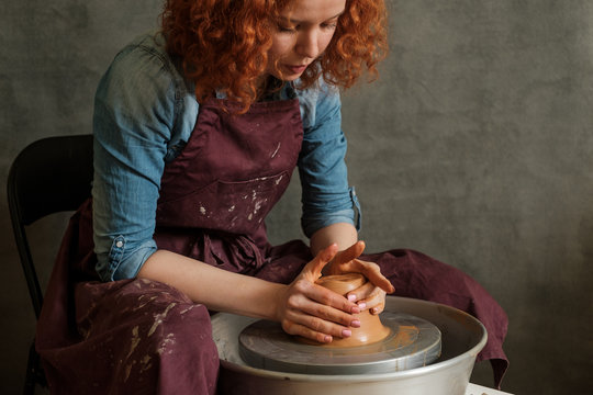 Woman Working On Pottery Wheel
