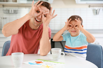Father and son having fun in kitchen