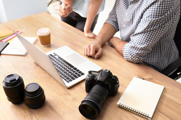 Photographers with laptop in office