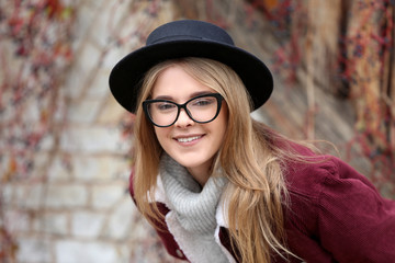 Attractive hipster girl in hat outdoors