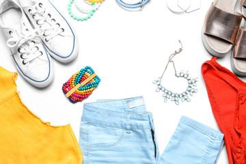 Stylish set of casual female clothes on white background