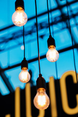 Lightbulbs Dangling from Glass Ceiling