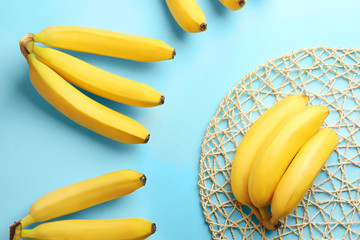 Composition with ripe bananas on color background