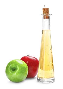 Bottle with apple vinegar and fresh fruit on white background