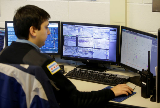 Chicago Police Officer Grand monitors the Police Observation Devices on computer screens in Chicago