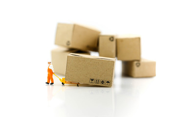 Miniature people: Worker and box with copy space using as background shipping, rent container, business concept.