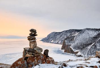 Pyramid of stones above ice lake