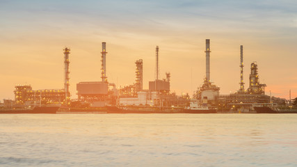 Refinery manufacturing industial during sunrise water front