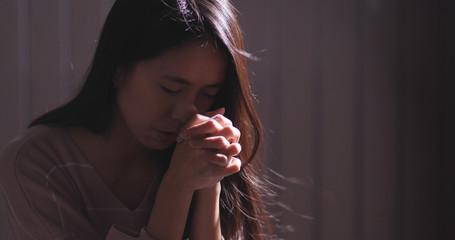 Christian women praying in the dark